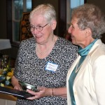 Bonnie Holmes, the Rotary Club's receipient of the Mercer Munn award in 2012 receives a clock and citation from Sue Moore for her many years of work with the Vicksburg Historical Society.